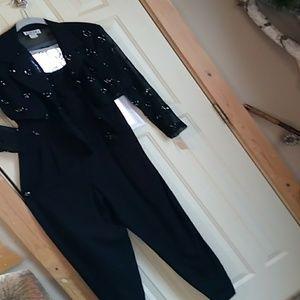 Beautiful Vintage  black jumpsuit sz.8 NWT.